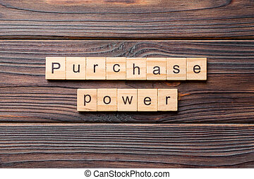 Purchase power word written on wood block. Purchase power text on cement table for your desing, concept