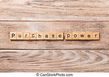 Purchase power word written on wood block. Purchase power text on wooden table for your desing, concept