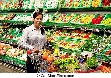 Young woman in the supermarket to buy food and fruit one.