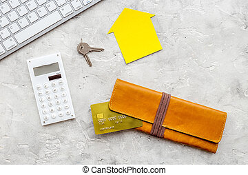 purchasing house with online card payment on work desk stone background top view mock up