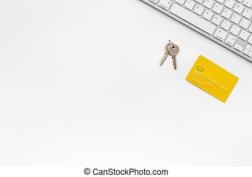 purchasing house with online card payment on work desk white background top view mock up