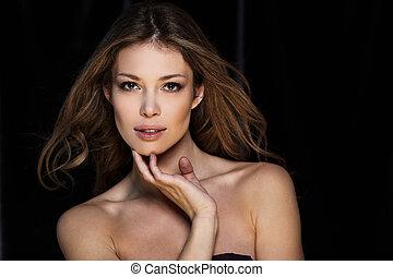 Pure beauty - Portrait of beautiful female model on black...