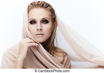 Pure beauty - Portrait of a young beautiful lady covered...