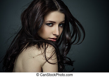 Pure beauty - Portrait of beautiful female model on gray...