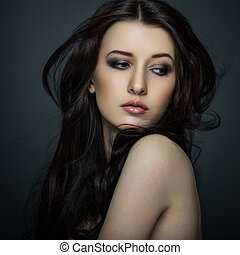 Pure beauty - Portrait of beautiful female model on gray...