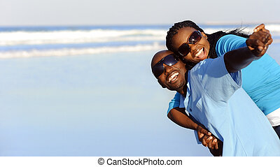 Pure joy - Attractive couple having fun together at the...