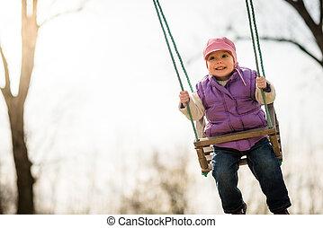 Pure joy - swinging child - Joyous little child swings...