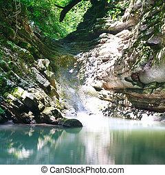 Pure mountain lake among southern jungle forests