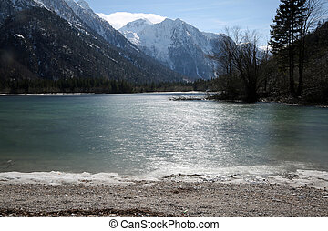 pure water of the alpine lake called Lago del Predil in Italian