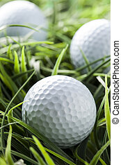Pure White Golfball on green grass - Pure White Golfball on...