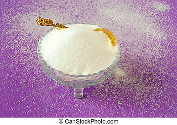 Pure White Granulated Sugar on a Magenta Background