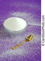Pure White Granulated Sugar on a Purple Background