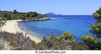 Pure white sand beach in the bay of Aegean Sea.