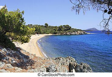 Pure white sand beach in the bay of the Aegean Sea.