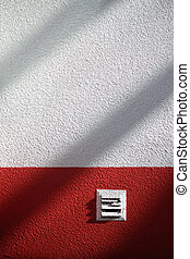 Pure white wall with a red stripe and shade