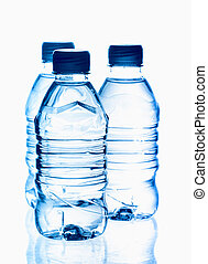 purified spring mineral water in the bottles with reflection
