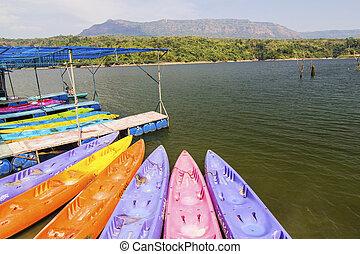 Yellow and orange Kayak on the lake