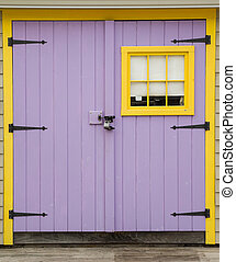 Purple and Yellow Barn door with padlock