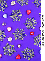 Purple background with snowflakes and candies
