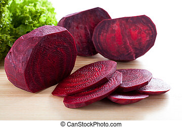 Purple beetroot on wooden board - Purple sliced beetroot...