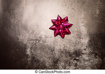 purple bow on a gray background