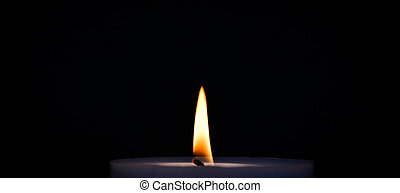 Purple burning candle with flame on black background