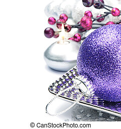 Purple Christmas ball on festive background