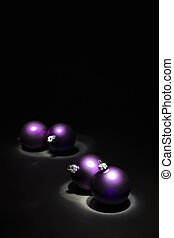 Purple Christmas balls on black background