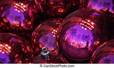 Purple Christmas balls reflecting sky