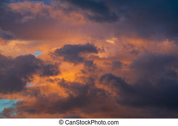 Purple clouds illuminated by disappearing rays at sunset. Majestic weather meteorology background