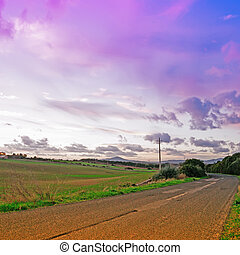 purple clouds over a country road