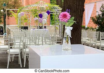 Purple dahlia at a wedding reception
