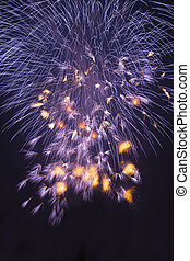 Purple fireworks on dark sky background. Background and texture of fireworks.