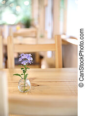 purple flower in jar on wood background in japanese restuarant