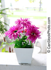 Purple flowers on table near the gl - The Picture Focus...
