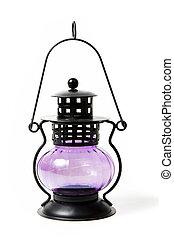 Purple glass vintage lamp on background