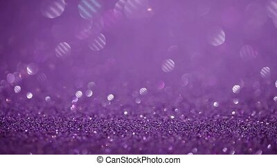 Purple glitter magic background. Defocused light and free...