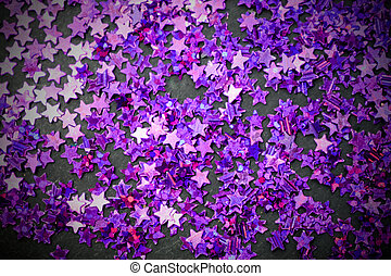 Purple glitter stars black background with copy space
