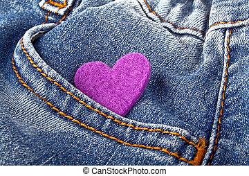 Purple heart in jeans pocket