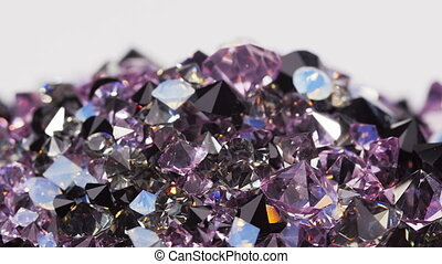 Purple jewel stones heap rotating - Purple jewel stones heap...