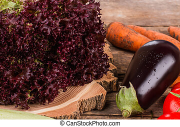 Purple lettuce, eggplant and other vegetables.