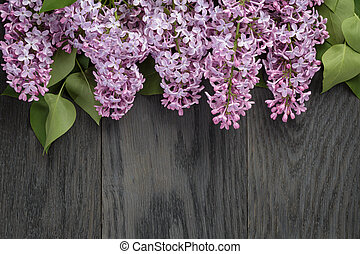 purple lilac flower on old oak table top view with copy space