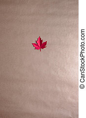 purple maple leaf cut from paper on neutral background