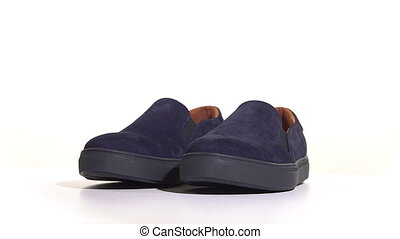 Purple mens slip-on sneakers on a white background. . Rotary...