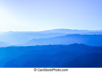 Purple mountains with sunlight