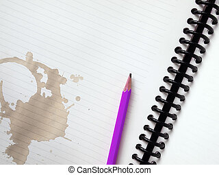 Purple pencil on white note book