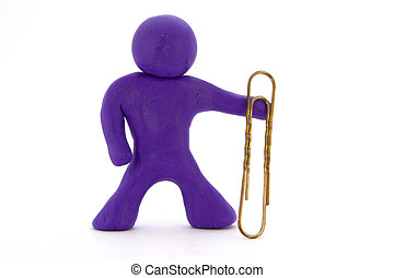 Purple plasticine character and big paperclip. Stationery. Isolated over white background