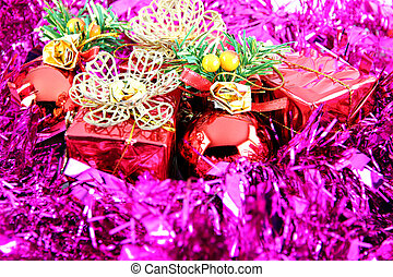 Purple ribbon and red gift box.