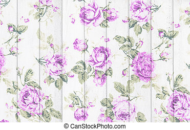 purple rose vintage from fabric on white wooden background