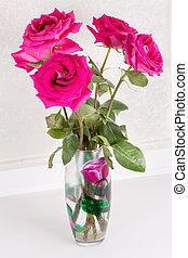 Purple roses in a vase